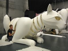 """Roger Titley's Creatures - Roger testing the movement of the sitting cat. creatures.co.za/...- M!a works on """"Pamuk"""" the reclining cat"""