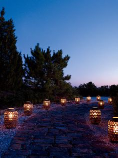 Brides: Romantic Lantern Wedding Decor . Large rattan lanterns guide partygoers to the big event.