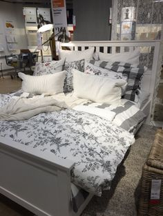 IKEA Hemnes bed for guest bedroom - love the grey and floral. Looks so cozy!
