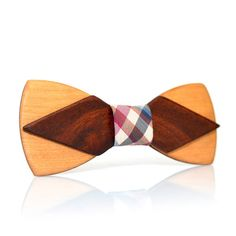 If you're looking for a unique accessory to finish out that wardrobe and add a smart look, look no further than the wooden bow tie. Stylish, handmade mens necktie from tropical strong tulip tree and mahogany tree. This item is covered with natural oils, polished and has HQ salient print on wood (you even can feel wood texture under your fingers!). Each item comes with a branded box, thus it might be a wonderful gift as well. Dimensions: 11 x 4.5 cm. (4.3x1.7 in.) Be inspired with MenEvolu...