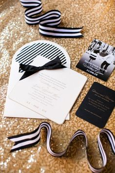 Modern gold and black wedding invitation - love the simple bow on top of the card