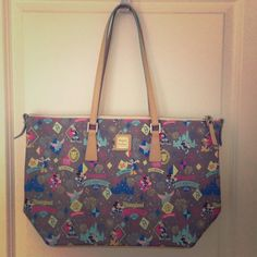 """Dooney + Bourke Disneyland Marathon Tote Love Disney? Love to run? """"Tote"""" around a lot of stuff? Then this is the bag for you! Very-rare and limited edition, this beautiful and vibrantly colored leather shopper is perfect for the ultimate fitness Mouseketeer. Who wouldn't want Mickey, Minnie, Goofy and Dumbo to tag along with you to school, the grocery store or your vacation? 17 x 11"""". Strap drop {10"""".} Pale gold hardware. Sky blue cloth lining with three open pockets and one zipper pocket…"""