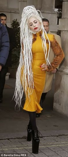 Awesome white dreads or sky high shoes, either way shear fabulousness