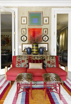Wall art, red settee, striped rug