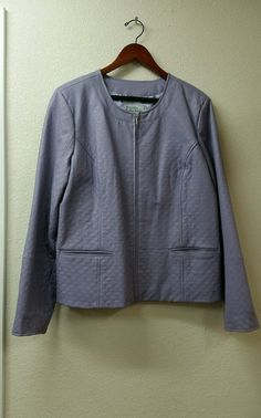 Grumpy Treasures Thrift & Consignment offers a Bradley by Bradley Bayou Scallop Quilted Leather Jacket in Lavender, Size XL NEW condition With tags. This quilted leather jacket is designed with an allover embroidered scallop pattern. Gorgeous and SO UNIUQUE in beautiful lavender purple. Jewel neckline, zip front, welt pockets, princess seams. Condition: Brand New with Tags. *Hanger not included in purchase.
