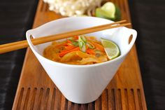 Red Curry, Coconut milk and Rice Noodle Thai Soup Recipe Soups with lemongrass, red curry paste, lime leaves, coconut milk, chicken broth, chicken breasts, mushrooms, red bell pepper, beansprouts, sliced carrots, fresh cilantro, red chili peppers, rice noodles, juice, carrots, green onions