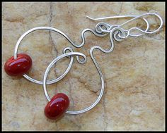 Artisan lampwork glass beads in sleek red on oxidized and hammered sterling silver wire.