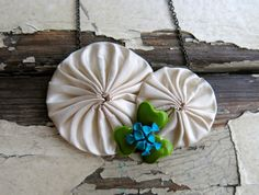 fabric necklace, yo-yo flower necklace, cream dupioni silk, vintage enamel bauble and gunmetal. one of a kind., via Etsy.