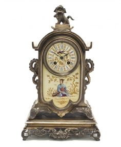 Aesthetic Movement Silvered Bronze and Porcelain Mantel Clock