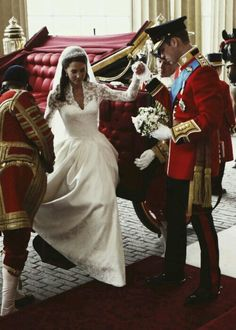 Prince William assisting his new bride Kate (Duke and Duchess of Cambridge) on their wedding day.  Sweet moment!