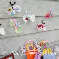 Activity idea - the kids color on coffee filter, then brush water on top and it makes a really pretty effect. Once dry, bunch them up and tie pipe cleaners around them to make butterflies