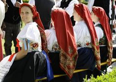 Women in traditional clothes arrive for the 60th Sudeten German meeting in Augsburg, Germany. Photo: Reuters
