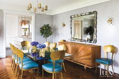 Inside a luminous Manhattan pied-a-terre with stunning views.  A teak buffet from Sabina Danenberg Antiques in Miami anchors the dining room. Above it are a vintage mirror from Liz O'Brien and Gaetano Sciolari sconces purchased through 1stdibs. Oly chairs with Moore & Giles teal leather surround a glass-topped table with a labradorite base from Remi Danielle Design in West Palm Beach.  See more: http://www.luxesource.com.