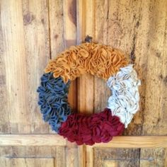 Felt wreath . . . Would use different colors, for sure, maybe multicolor autumn hues