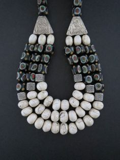 Nepalese Conch Shell, India Glass Beads & Silver Necklace by GEMILAJewels on Etsy https://www.etsy.com/listing/156767979/nepalese-conch-shell-india-glass-beads