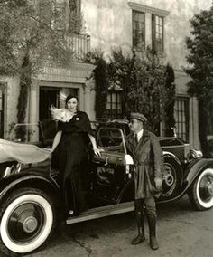 Marlene Dietrich & her chauffeur, Briggs, 1931. They're showing off the Rolls Royce given to her by Josef Von Sternberg. (via Decaying Hollywood Mansions)
