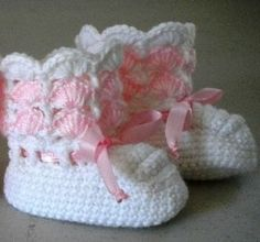 Pink / white crochet baby booties adorned with pink ribbon . . . just precious!