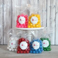 favor bag two tier display - clear bags, cute tie with tag, mini gumballs, toy ball?