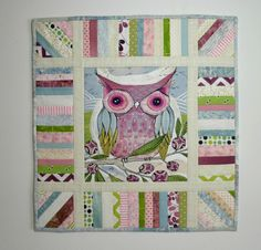 Quilt with embroidery, really cute!