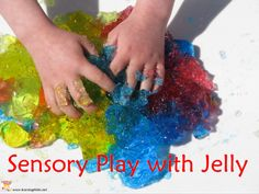 Exploring the sense of touch! We talked about all the wonderful describing words of how the jelly felt in our hands. Squishy, sticky, slippery, slimey, sloppy andsmooth. We joked about how it would feel to have a bath in a tub full of jelly.