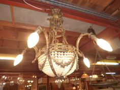 Chandelier 19th century - A late XIXth century Bronze chandelier in Louis XVI style  Balloon model, bronze, late XIXth century ; beautiful decorations of drapes, garlands of flowers, and in working condition, very good quality