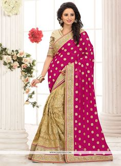Make the heads flip whenever you costume up in this desirable hot pink net and georgette half n half designer saree. This attractive attire is displaying some incredible embroidery done with embroider...