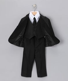 What a stud! Any little man will look all grown up and daringly debonair in this classic black suit. Even if he's a little nervous to bear the rings, he'll feel cool and confident as he steps left, together, right, together down the aisle.