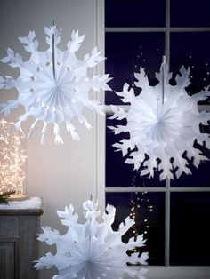 Create a festive party atmosphere with our set of twelve retro paper snowflake decorations. Each has holes for hanging, and is easy to assemble - simply twist open and secure the cardboard ends together with wire or thread.
