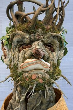 """Sculptor Philip Haas - The sculpture looks like a giant face, like a portrait, and it is made of bark, twigs, branches, fungi, moss, etc. It is an imitation of Arcimboldo's 1563 painting """"Winter"""". It has a really expressive face that gives the whole sculpture a lot of life."""