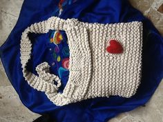 Knitted iPad bag with felted heart