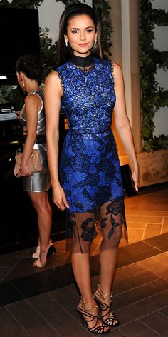Dobrev paired her lace sheath with drop earrings, a crocodile Nancy Gonzalez box clutch and strappy sandals at the Women in Hollywood event.