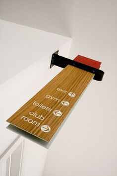 modern metal and wood wayfinding