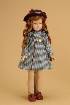 Effanbee Dewees Cochran American Child, America, circa 1940, all composition doll, marked Effanbee American Children, portrait face with painted features, brown sleep eyes, [closed mouth], and long curly brown human hair wig. Wearing original cranberry cotton dress under a black and white checked coat with matching hat and shoes and Effanbee pin.
