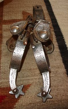 These spurs are single mounted (meaning only the outside heel band has silver on it) with engraved sterling overlay. The spurs are Northern ...