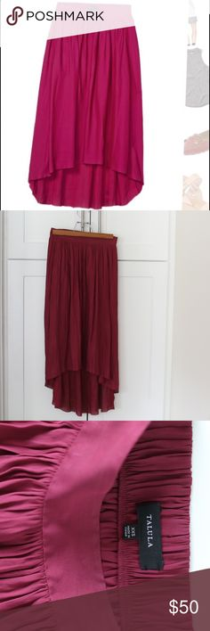 High Low Maroon Aritzia Talula Chouette EUC High Low Maroon Aritzia Talula Chouette EUC. No signs of wear. Pockets too! Perfect to bundle with the two other Aritzia skirts I'm selling. Aritzia Skirts High Low