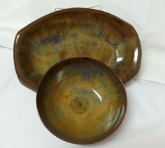 Serving tray and bowl made from stoneware clay. The bowl was thrown on the potters wheel while the tray was created from a clay slab. Glazed with layers of Potters Choice Smokey Merlot and Ancient Jasper. Created by Ann Augustin Pottery, Frisco, TX.