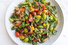 All-The-Tomatoes & Pasta Salad - Tomatoes & pasta in an A+ one-bowl meal -  whole-grain pasta, baby kale, basil, and the best tomatoes you can get your hands on, with a generous drizzle of strong harissa dressing. - from 101Cookbooks.com
