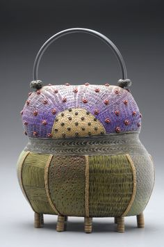 Izmir Purse made of colored polymer clay with intricately hand-applied texture in layers of pattern. Kathleen Dustin