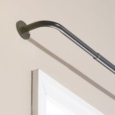 Sleep in as late as you like when you hang blackout drapes on this wraparound curtain rod, designed with mounts that sit flush against the wall to keep out sunlight. This blackout curtain rod is a vit Ceiling Mount Curtain Rods, Window Curtain Rods, Curtain Hanging, Blackout Curtains, Drapes Curtains, Curtain Fabric, Fabric Decor, Shower Curtains, Modern Window Treatments