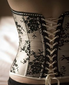 Love the contrast of black tape on white corset with white lacing