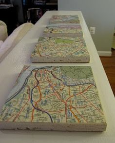 drink coasters made from maps and tiles and cork.