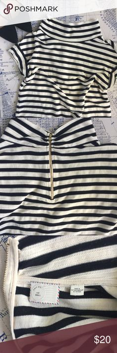 Anthropologie Postmark Mockneck Striped Top Anthropologie Postmark Mockneck Black and White Striped Top. Short sleeve with gold zipper up the back. In good used condition. Anthropologie Tops Blouses