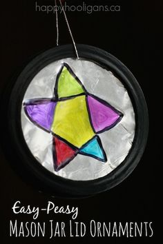 These Easy Mason Jar Lid Ornaments have a stained glass look to them. They're super-easy for kids of all ages to make with aluminum foil and Sharpies. - Happy Hooligans