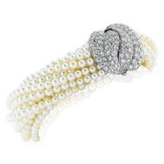 Multi-Strand Pearl Bracelet with Diamond Platinum Clasp | From a unique collection of vintage more bracelets at https://www.1stdibs.com/jewelry/bracelets/more-bracelets/