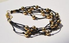 Black Knotted Bracelet with gold plated balls on Waxed by dzinebug, €16.00