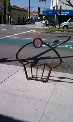 Cupcake bike rack-would be so cute in front of my shop :)