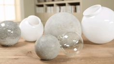 Make these inexpensive and fun concrete ball accents for your garden using surprising tools -- either a glass globe for a light fixture or a glass Christmas ornament. Watch and learn how.