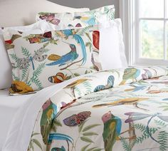 Duvet Set. I love birds...and dragon flys! Bright too. Pottery Barn
