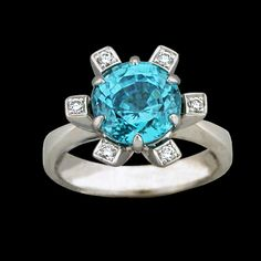 18K White Gold Ring with Blue Zircon (4.99ct) six prong set and Diamonds (.11cttw) pav