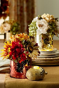 Featuring expertly handcrafted faux flowers in rich autumn hues, Pier 1's Pre-Lit Faux Sunflower Arrangement is set in a mercury glass vase that's lit from within. Its gentle glow could make it the centerpiece of your fall table, entryway or mantel.